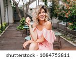 dreamy girl with elegant wavy...   Shutterstock . vector #1084753811
