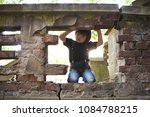 little boy is playing around... | Shutterstock . vector #1084788215