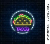 neon glowing sign of tacos in... | Shutterstock .eps vector #1084804559