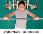 obese fat boy weight lifting in ... | Shutterstock . vector #1084807031