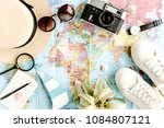 traveler accessories on map... | Shutterstock . vector #1084807121