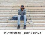stressed african american man...   Shutterstock . vector #1084815425