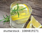 water with lemon and rosemary... | Shutterstock . vector #1084819271