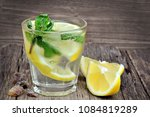 water with lemon and mint in a... | Shutterstock . vector #1084819289