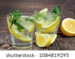 detox water with lemons and... | Shutterstock . vector #1084819295