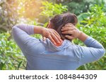woman suffering from neck pain... | Shutterstock . vector #1084844309