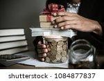 businessman giving money... | Shutterstock . vector #1084877837