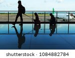 mother with kids walk to flight ... | Shutterstock . vector #1084882784