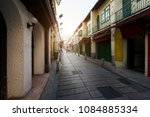 scenic street in the old town... | Shutterstock . vector #1084885334
