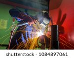 welder at work with fire blaze | Shutterstock . vector #1084897061