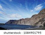 sky above rocks and stony coast.... | Shutterstock . vector #1084901795