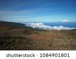 sky above rocks and stony coast.... | Shutterstock . vector #1084901801