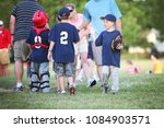 Small photo of High Five line after a children's baseball game
