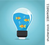 golden fishes swimming in the...   Shutterstock .eps vector #1084906811