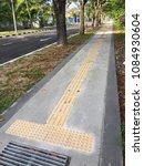 a disable friendly pedestrian... | Shutterstock . vector #1084930604