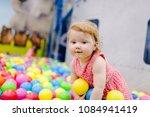 portrait little cute baby girl... | Shutterstock . vector #1084941419