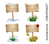 set of wooden signs in four... | Shutterstock .eps vector #1084943657