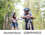 happy father and daughter... | Shutterstock . vector #1084944035