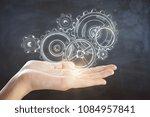 hand holding abstract cogwheel... | Shutterstock . vector #1084957841