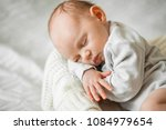 sleeping newborn baby on a... | Shutterstock . vector #1084979654