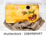 raw beef with rosemary and four ... | Shutterstock . vector #1084989497