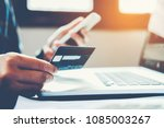 man holding credit card and... | Shutterstock . vector #1085003267