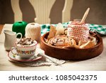 coffee with cream and danish... | Shutterstock . vector #1085042375