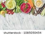 healthy vegan snack plate. flat ... | Shutterstock . vector #1085050454