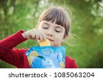 child eats chips. selective... | Shutterstock . vector #1085063204
