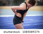 athlete woman has side crumps ... | Shutterstock . vector #1085089274