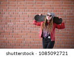 a young hipster girl is riding...   Shutterstock . vector #1085092721