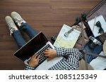 overhead view of traveler woman ... | Shutterstock . vector #1085125349