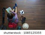 overhead view of traveler woman ... | Shutterstock . vector #1085125355