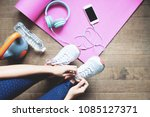 sport and healthy woman tying... | Shutterstock . vector #1085127371