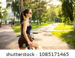 young happy woman on bike...   Shutterstock . vector #1085171465