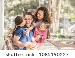 Small photo of family lifestyle portrait of a mum and dad with their children having good time
