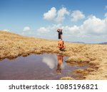 hiker drinking water from... | Shutterstock . vector #1085196821