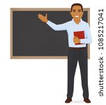 Male Teacher At Blackboard Wit...