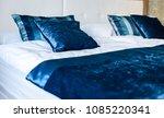blue silky hotel room bedding... | Shutterstock . vector #1085220341