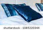 blue silky hotel room bedding... | Shutterstock . vector #1085220344