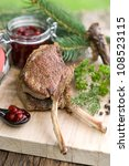 Chop of venison on wooden ground - stock photo