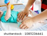 close up of father changing... | Shutterstock . vector #1085236661