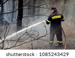 Small photo of A firefighter works to extinguish a fire in Ouranoupoli, Greece on Aug. 9, 2012