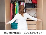 woman looking clothing in her... | Shutterstock . vector #1085247587