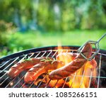 grilled sausages on grill with... | Shutterstock . vector #1085266151