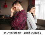 couple sitting back to back on... | Shutterstock . vector #1085308061