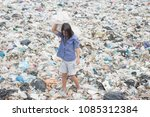 poor girl with a heavy bag with ... | Shutterstock . vector #1085312384
