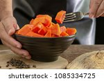 ripe papaya fruit cut into... | Shutterstock . vector #1085334725