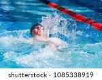 backstroke swimmer in a race | Shutterstock . vector #1085338919