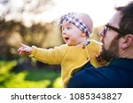 a father with his toddler... | Shutterstock . vector #1085343827